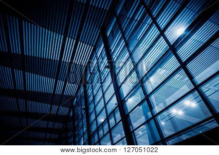 low angle view of steel glass airport ceiling ,chongqing china,blue toned image.