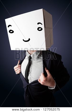 Businessman standing and gesturing with a cardboard box on his head with smiley face