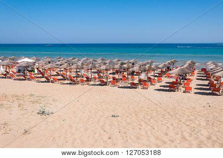 Sunbeds on Banana beach famous beach on Zakynthos Island Greece