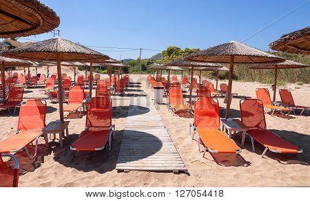 Sunbeds on Banana beach famous beach of Zakynthos Island Greece