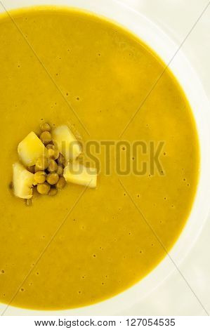 Top view of a green pea soup