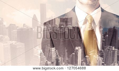 Handsome business man with overlay cityscape background