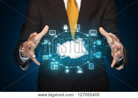 Businessman holding digital icons, Cloud computing concept