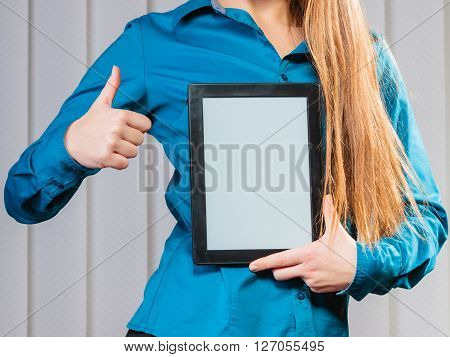 Technology help in career business and work advice first job. Young woman hold tablet portable computer show advice and help with thumbs up.