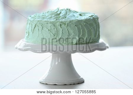 Big lime cake on a white stand