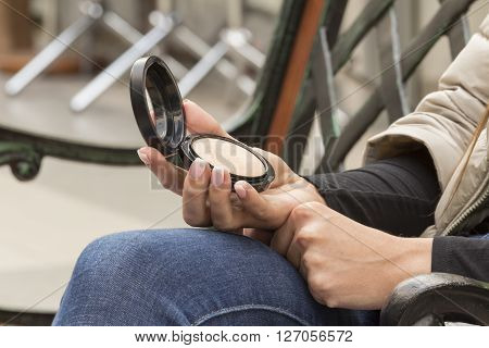 Compact mirror in the girl in the hands with a French manicure ** Note: Soft Focus at 100%, best at smaller sizes