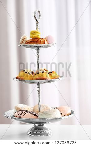 Cake stand with different sweets.