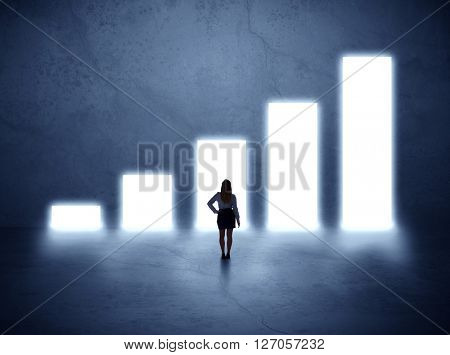 Businesswoman standing in the front of growth chart of profits