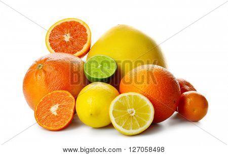 Mixed citrus fruit including lemon, limes, grapefruit, pomelo, orange and tangerine isolated on a white background, close up