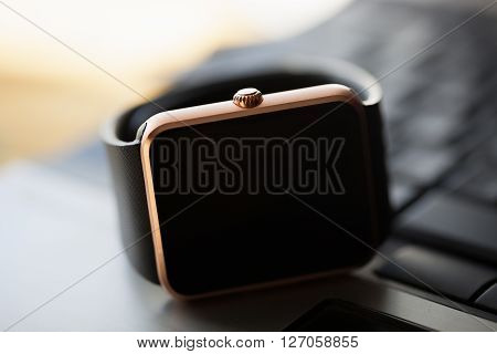 Smart Watch On Laptop Keyboard
