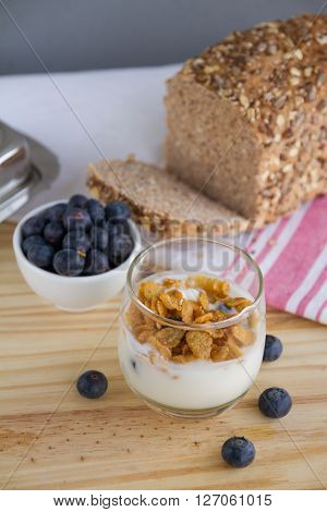Healthy Breakfast: Yogur With Blueberries And Corn Cereals And Homemade Wholemeal Bread
