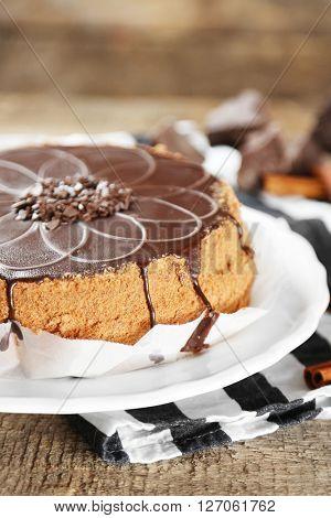 Tasty chocolate cake on wooden background
