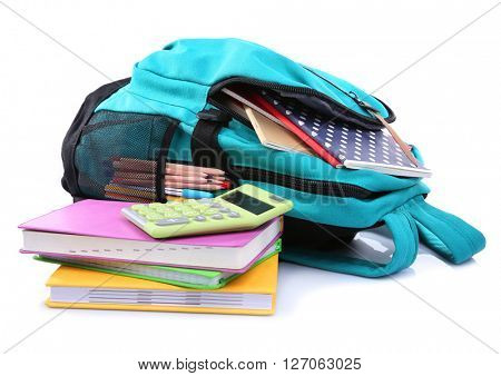 Backpack with school supplies, isolated on white
