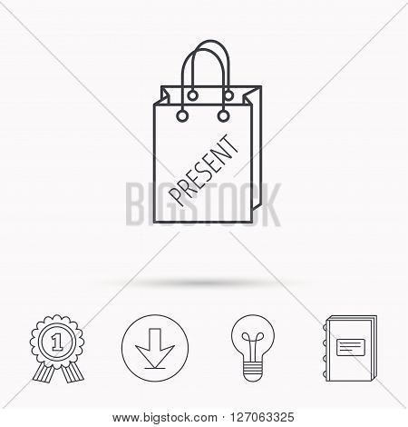 Present shopping bag icon. Gift handbag sign. Download arrow, lamp, learn book and award medal icons.