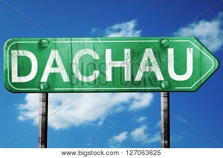 Dachau road sign, on a blue sky background