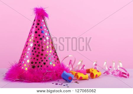Pink party hat on pink background