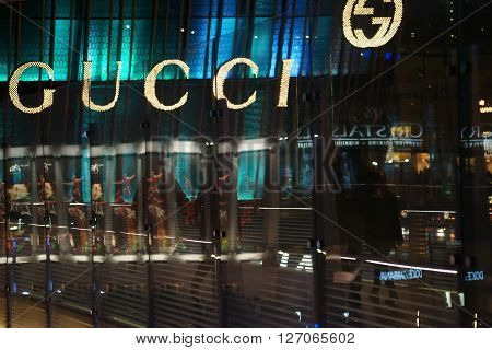 LAS VEGAS, USA - DECEMBER 23, 2015: Abstract reflections in a glass passage in front of the shop window of the boutique and fashion label Gucci on December 23, 2015 in Las Vegas.