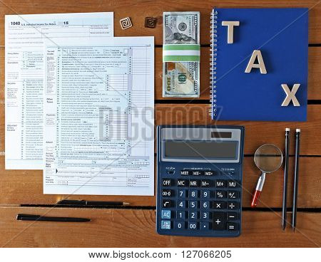 Individual income tax return, form 1040 with calculator and notebook