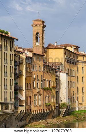 View of the traditional houses in Florence near the Arno river, Italy.