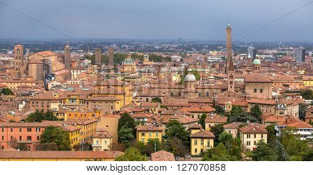 Aerial view of red tiled rooftops and ancient towers in historical center of Bologna, Italy