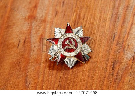 Order Of The Patriotic War In St. On A Wooden Background