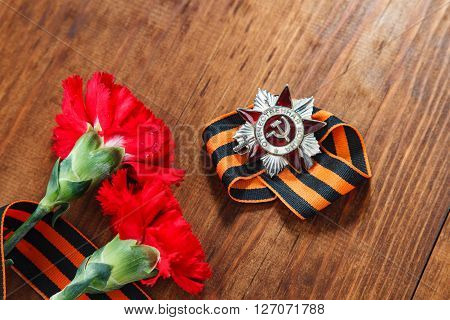 Order Of The Patriotic War 1St Class And Two Red Carnations. Still Life Dedicated To Victory Day. 9