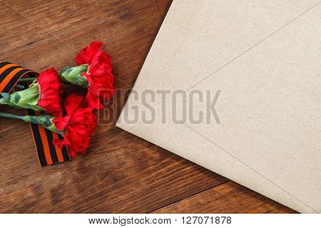 Symbols Of Victory In Great Patriotic War Three Red Flower And Paper On A Table.  Selective Focus Im