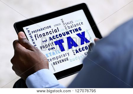 Tax concept. Male hands with tablet, close up