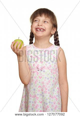 lost tooth girl child portrait with green apple, studio shoot isolated on white background
