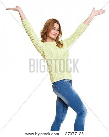 young girl casual dressed jeans and a green sweater posing open arms in studio on white background