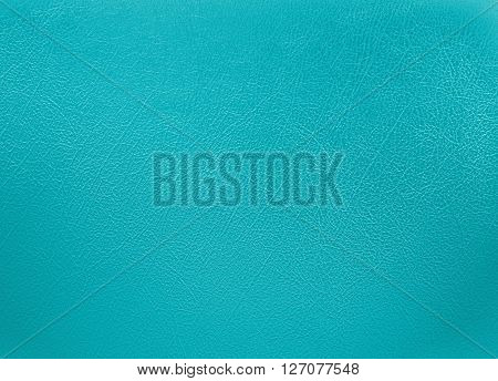 close up Turquoise colored leather texture background