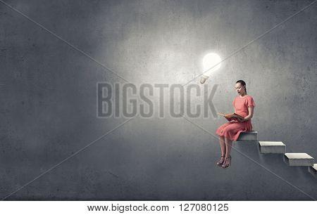 Girl in dress read book