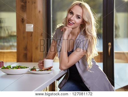 Happy Woman Having Healthy Breakfast. Healthy food