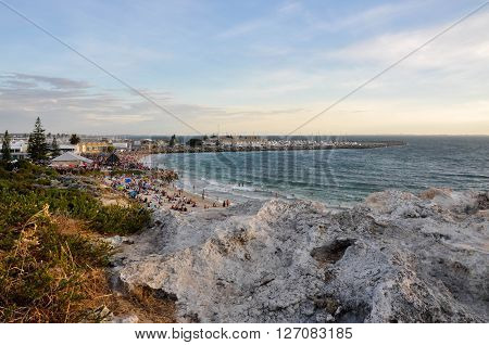 FREMANTLE,WA,AUSTRALIA: JANUARY 26,2016: Limestone overlooking Bather's Beach at twilight with people on Australia Day in Fremantle, Western Australia.