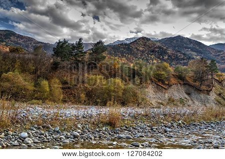 autumn landscape mountain river mountains covered with colorful vegetation Russian North Caucasus