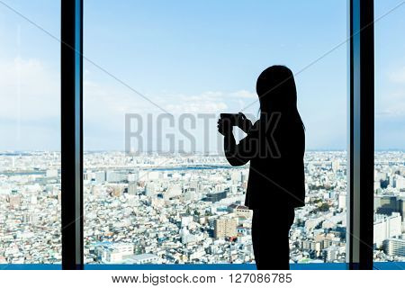 Silhouette of woman shooting photo