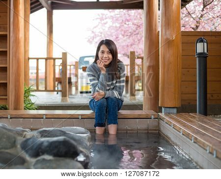 Woman enjoy her foot onsen in Japan