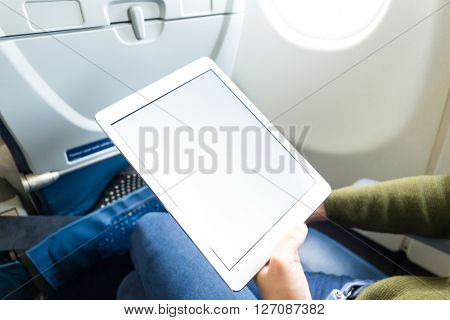 Woman hold with digital tablet in plane