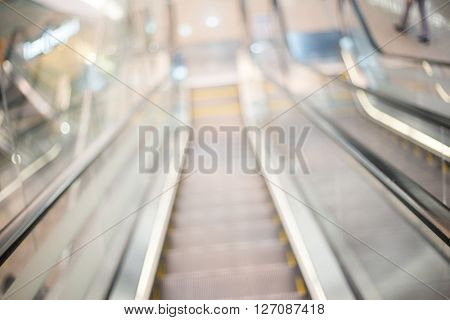 Blurred image of escalators stairway
