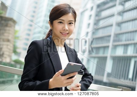 Businesswoman hold with cellphone and coffee