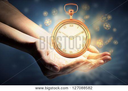 Pocket watch in palms
