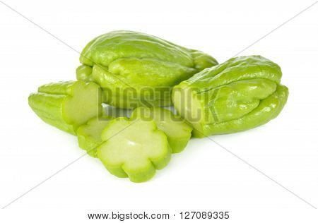whole and sliced fresh chayote on white background