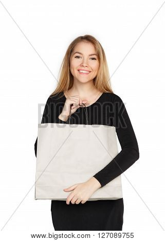 Young Woman In A Black Dress With Shopping Bags, Isolated On A White Background.