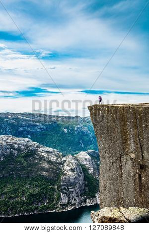 Preikestolen or Prekestolen, also known by the English translations of Preacher's Pulpit or Pulpit Rock, is a famous tourist attraction in Forsand, Ryfylke, Norway
