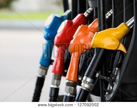 Four different fuel nozzles in gas station