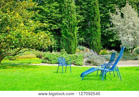 beautiful summer park with lawn and recliner