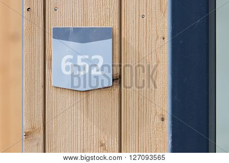 652 street number on a wooden bungalow