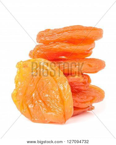 heap of dried apricots isolated on white background closeup.