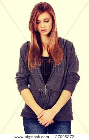 Unhappy and thoughtful teenage woman