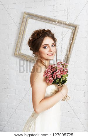 Wedding dress fashion, beautiful young bride portrait in vintage, shabby chic wedding dress with bridal bouquet.